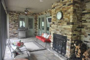 Screened porch/fireplace of 2260 Country Club Dr